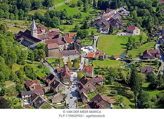 Aerial view over the Baume Abbey / Abbaye Saint-Pierre de Baume-les-Messieurs and village, Jura department in Franche-Comté, Lons-le-Saunier, France