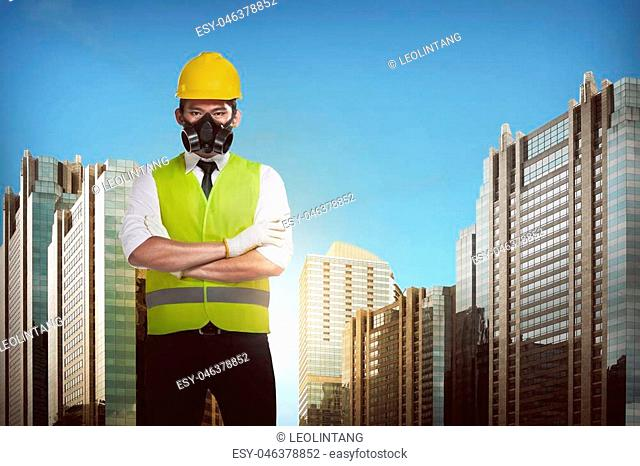 Asian engineer wearing safety vest. Industrial concept