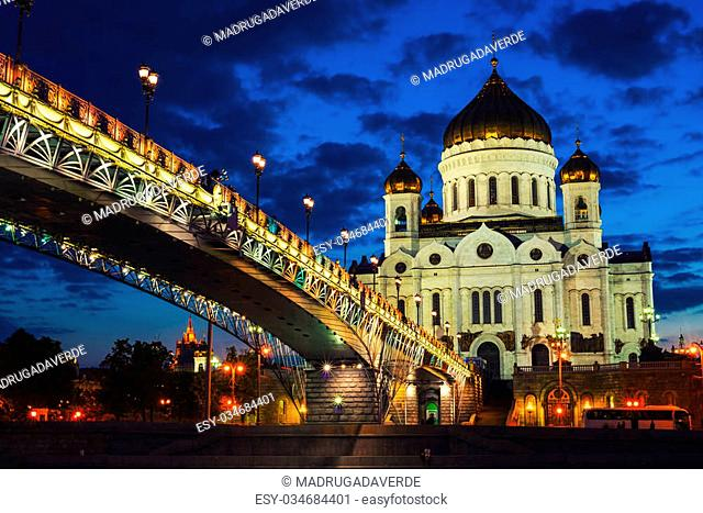 Beautiful illumination of Cathedral of Christ the Savior, Moscow, Russia and Patriarshiy Bridge at Night. Sunset sky