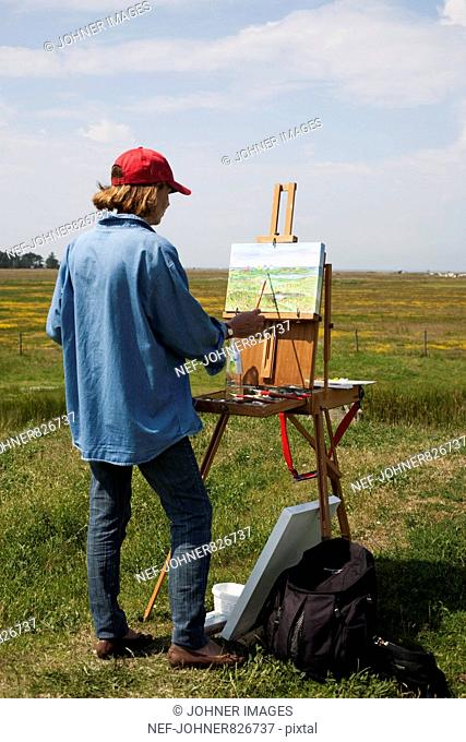 Woman painting outdoors, Sweden