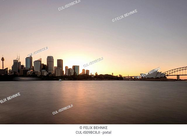 Sydney opera house and skyscrapers on skyline, Sydney, New South Wales, Australia