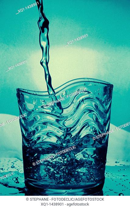 Water glass, with water pouring