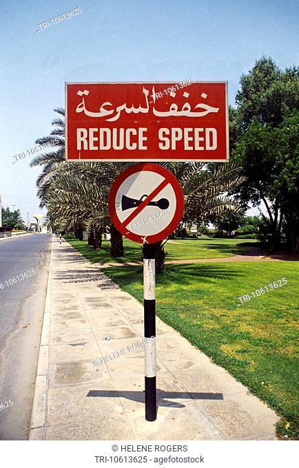 Dubai UAE Bilingual Road Sign Reduce Speed