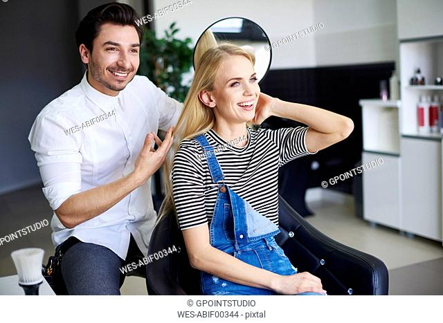 Happy woman at the hairdresser
