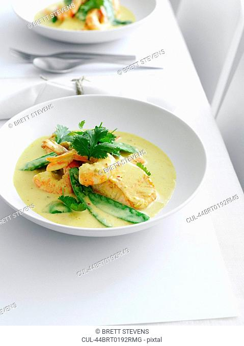 Plate of chicken curry with vegetables