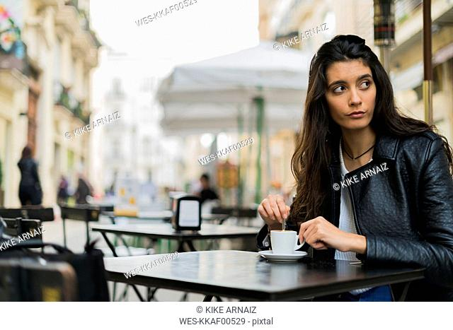 Young woman in a street cafe