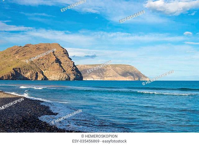 Las Negras beach with its dark volcanic rocks, Cabo de Gata, Andalusia, Spain