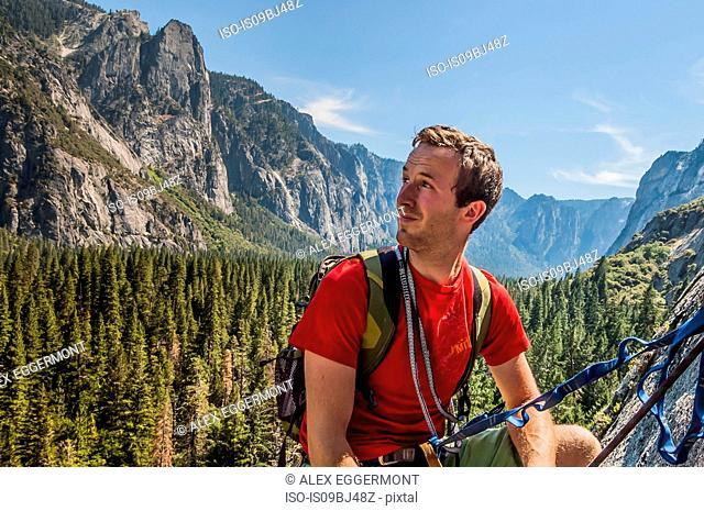 Rock climber, looking away at view, Yosemite National Park, United States