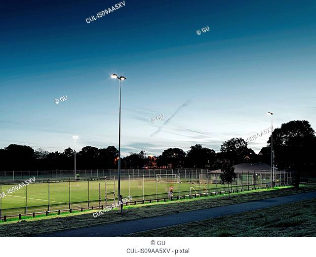 Football pitch at dusk, Manchester, England