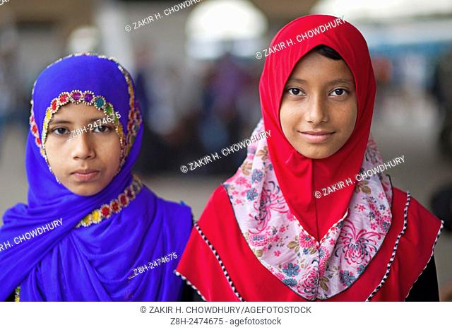 DHAKA, BANGLADESH 16th July : Bangladeshi passengers waiting for a train, as they head to their homes to celebrate Eid al-Fitr in Dhaka on 16th July 2015
