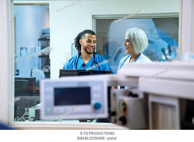 Smiling doctor and nurse talking