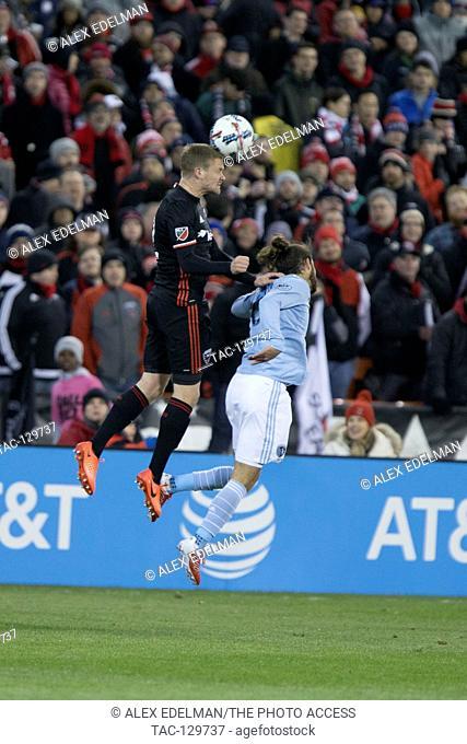D.C. United defender Taylor Kemp (2) battles Sporting Kansas City midfielder Graham Zusi (8) for a 50-50 ball during D.C