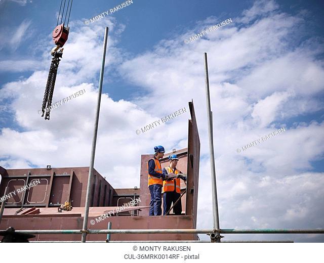 Engineers examining ship parts
