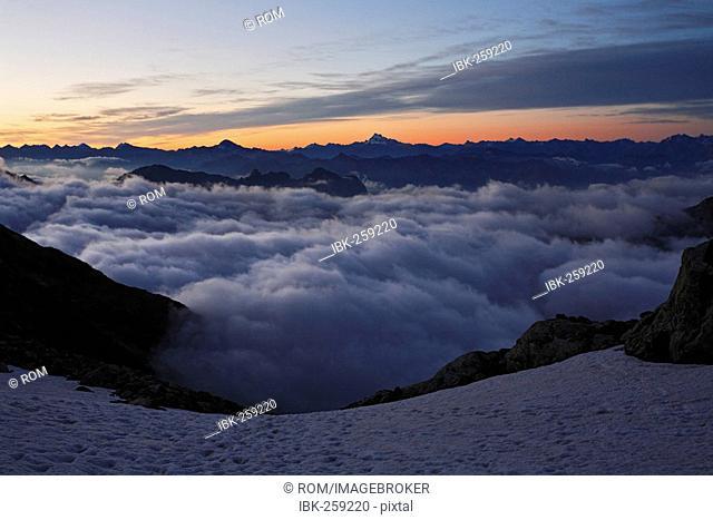 Ascent to Mont Pelvoux 3.946 m, view at Cottian Alps with Monviso, Provence-Alpes-Cote de Azur, Hautes-Alpes, France
