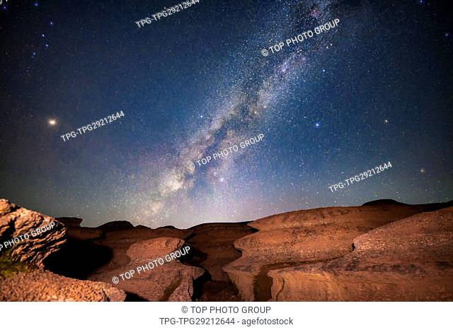 Milky way of Starry Night upon the Rock in the desert; somewhere unknown