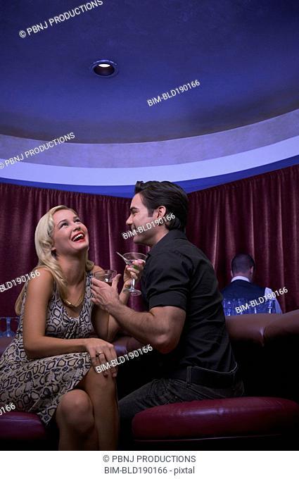 Couple laughing at nightclub