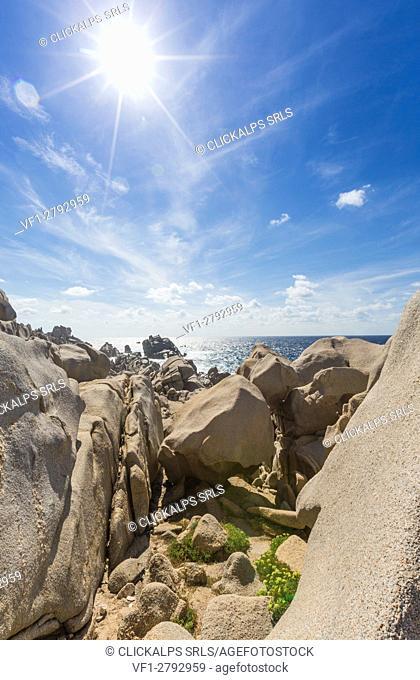 Sun shines on turquoise sea framed by molded cliffs Capo Testa Santa Teresa di Gallura Province of Sassari Sardinia Italy Europe