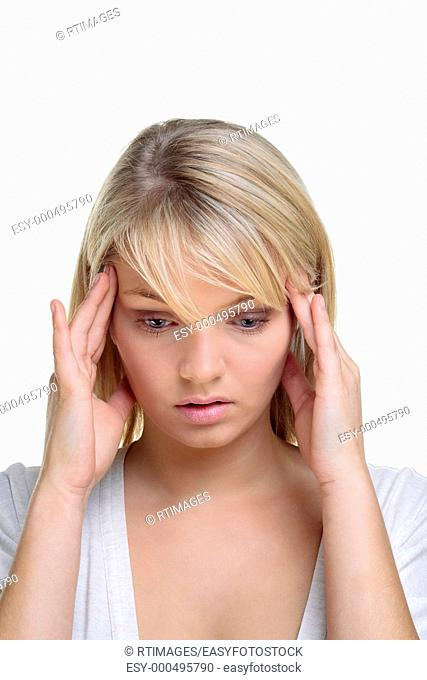 Blond woman with her hands on the side of her head in deep thought, white background