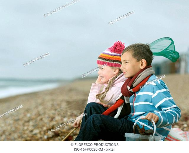 Boy and Girl at Beach looking to Sea
