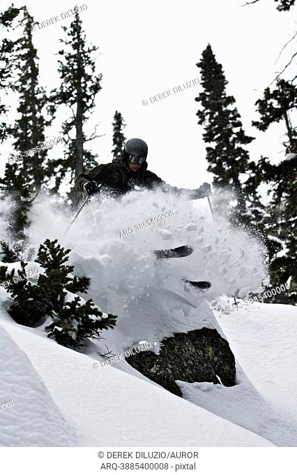 A man skis off a rock in the Wyoming