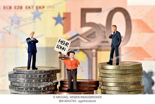 Symbolic image for capital, two managers and a union worker on coins in front of 50 euro banknote