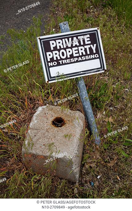 "Sign on ground reading, """"Private Property - No Trespassing"""""