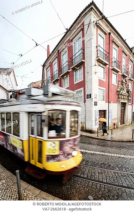 Yellow tram number 28 performs the longest route leading from centre of town up to the top of Alfama Lisbon Portugal Europe