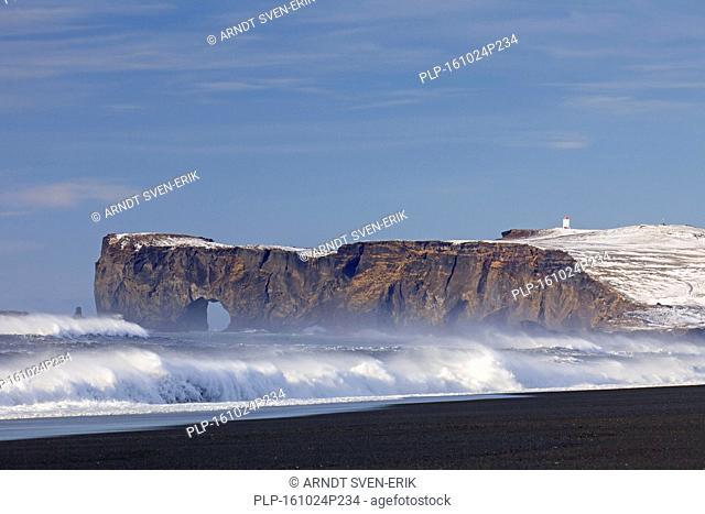 Black arch of lava near Vík í Mýrdal at the Dyrhólaey peninsula in winter, south coast of Iceland