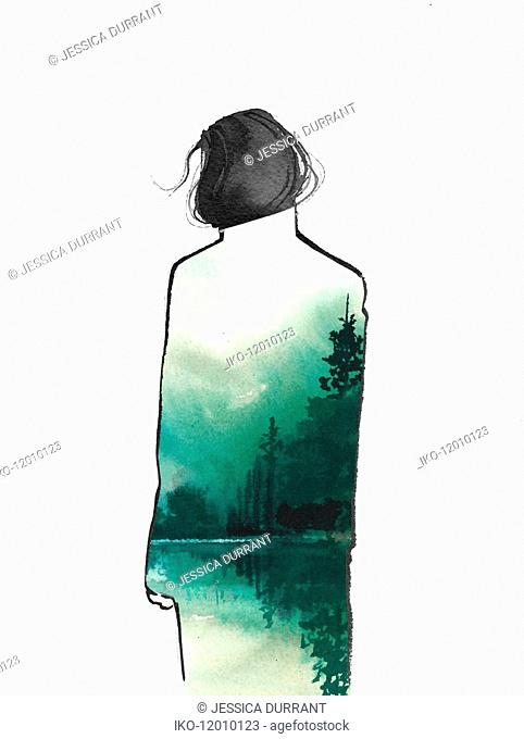 Rear view of woman wearing overcoat with atmospheric tranquil scene