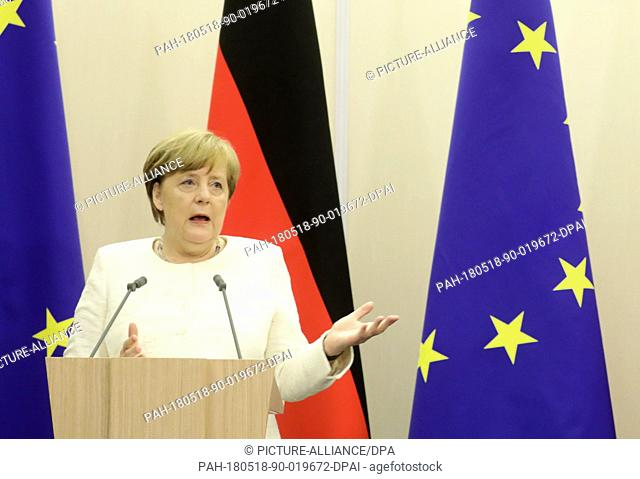 18 May 2018, Russia, Sochi: German Chancellor Angela Merkel (CDU) speaking at a press conference after her meeting with Russian President Vladimir Putin