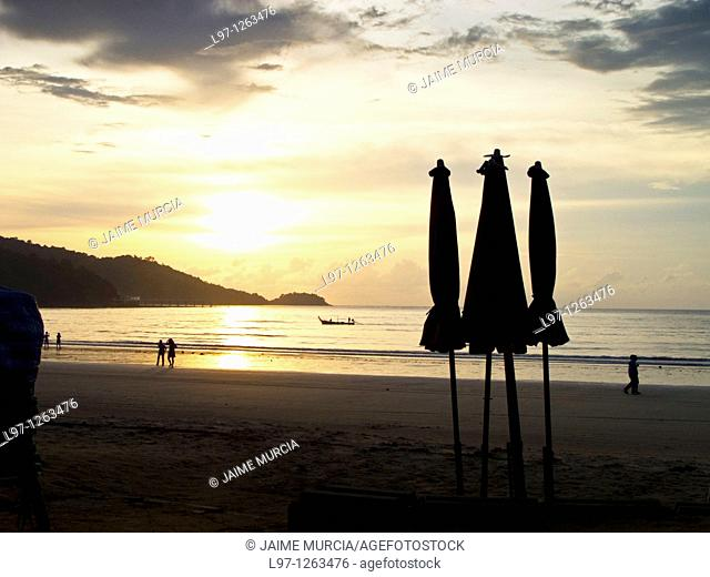 Silhouette of umbrellas at dusk on Patong beach Phuket, Thailand