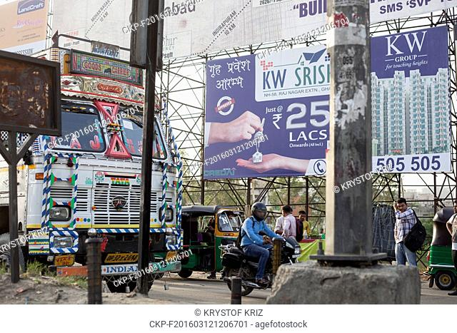Advertising billboards announcing new flats available for sale in Greater Noida, India on July 15, 2015. Construction, billboards, advertising, advertisement