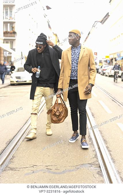 two stylish men walking on street in city, streetstyle, in Munich, Germany