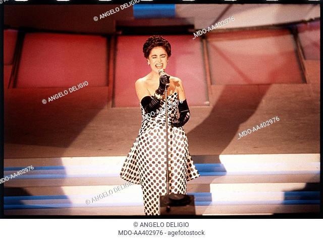 Italian singer Mia Martini (Domenica Berté) performing on the stage of the Ariston Theatre during the 39th Sanremo Music Festival