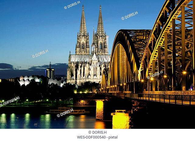 Germany, Cologne, View of Cologne Cathedral and Hohenzollern Bridge with River Rhine