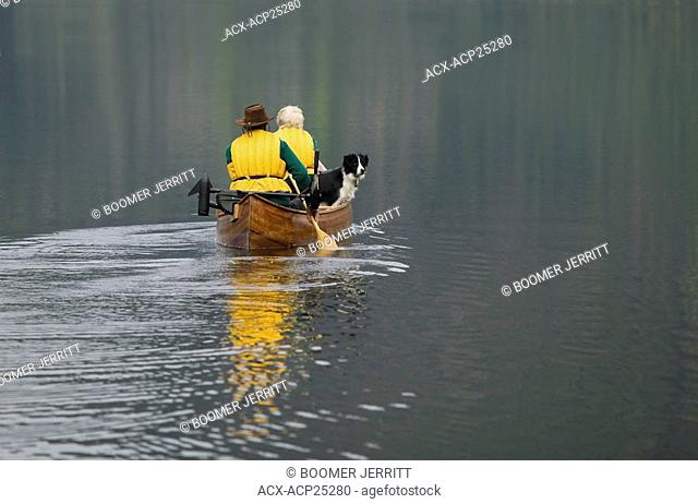 Paddlers in a canoe on Muchalat Lake near Gold River, Vancouver Island, British Columbia, Canada