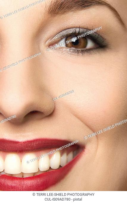 Cropped studio portrait of young woman smiling