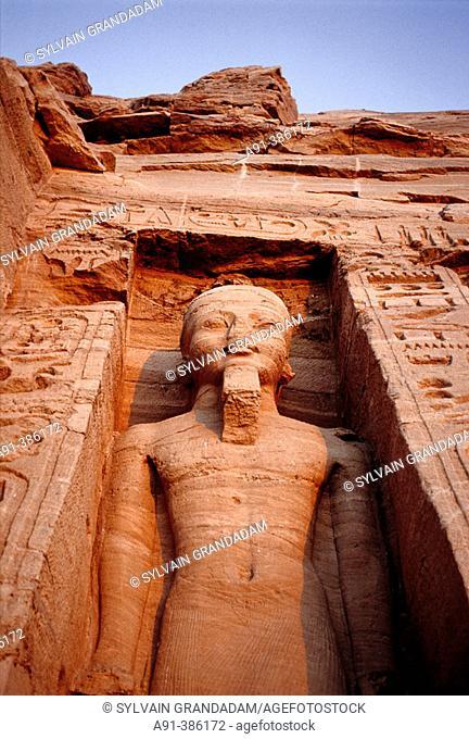 Statue of Ramesses II. Nefertari (Ramses II wife) Temple on Lake Nasser bank. Abu Simbel. Nubia. Egypt
