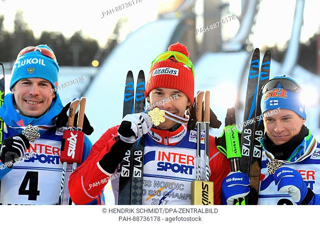 Alex Harvey (c) from Canada (gold), Sergej Ustjugow (l) from Russia (silver) and Matti Heikkinen from Finland (bronze) show their medals after the men's 50 km...
