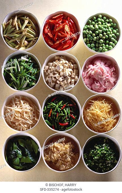 Various ingredients for Asian cuisine in small bowls