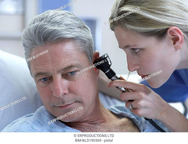 Female medical professional examining patient