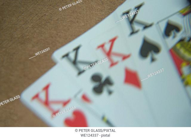 Close-up of four Kings playing cards