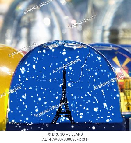 Figurine of Eiffle Tower in snow globe