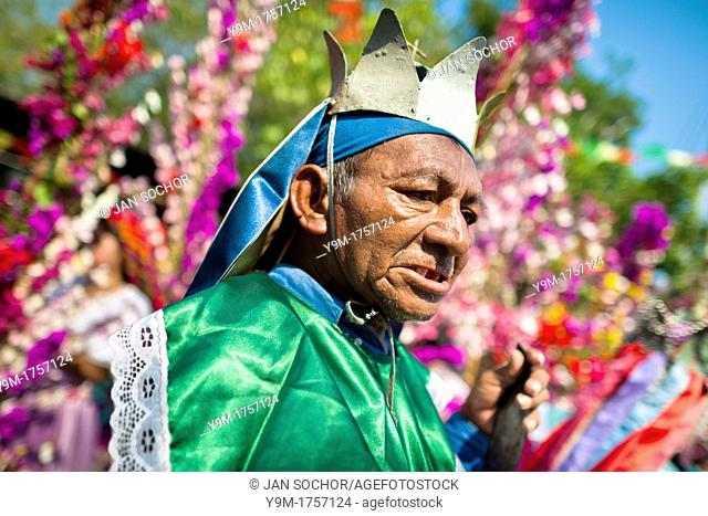 """A member of a dance group """"Los Historiantes"""" performs the Dance of the Moors and Christians during the Flower & Palm Festival in Panchimalco, El Salvador"""