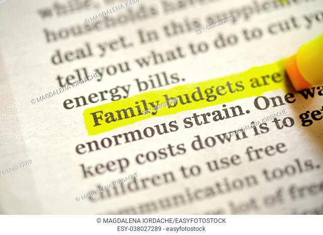 Family budget Using A Highlighter Marker on newspapper