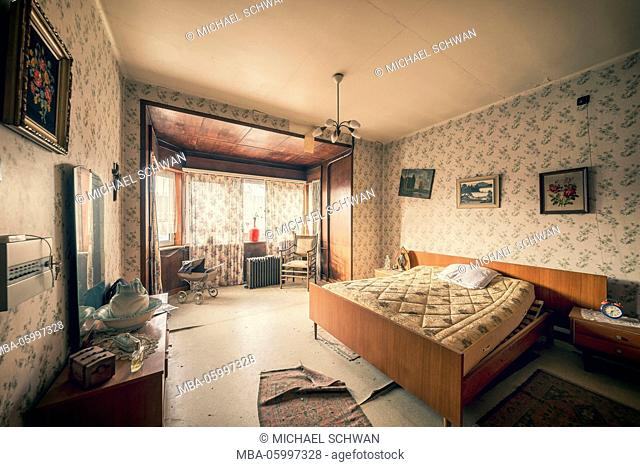 The bedroom in a deserted residential house, abandoned for decay