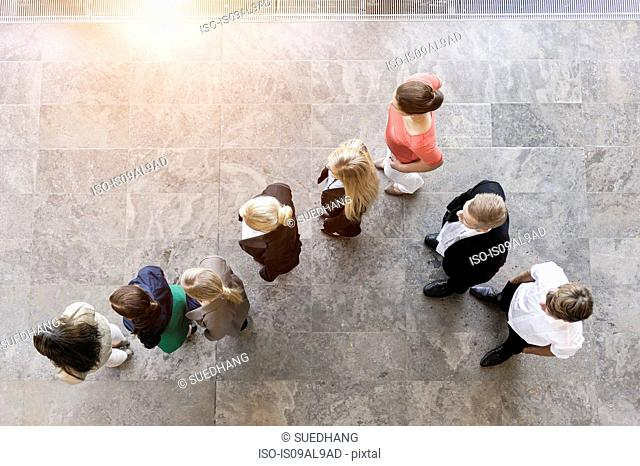 Overhead view of business team watching and listening in office