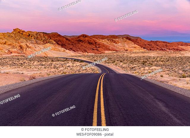 USA, Nevada, Valley of Fire State Park, sandstone and limestone rocks, scenic road at twilight