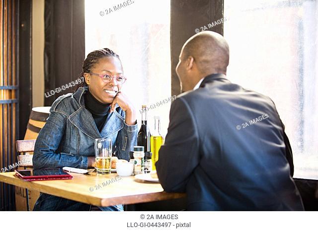 Couple talking in restaurant, Johannesburg, South Africa