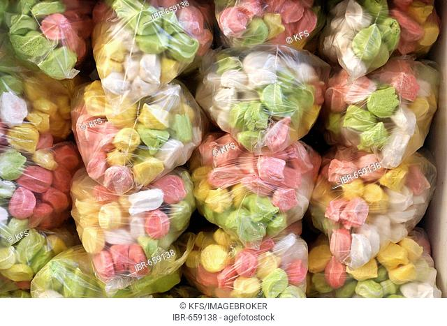Colourful candy wrapped in plastic in a shop window, historic Medina quarter, Marrakesh, Morocco, Africa